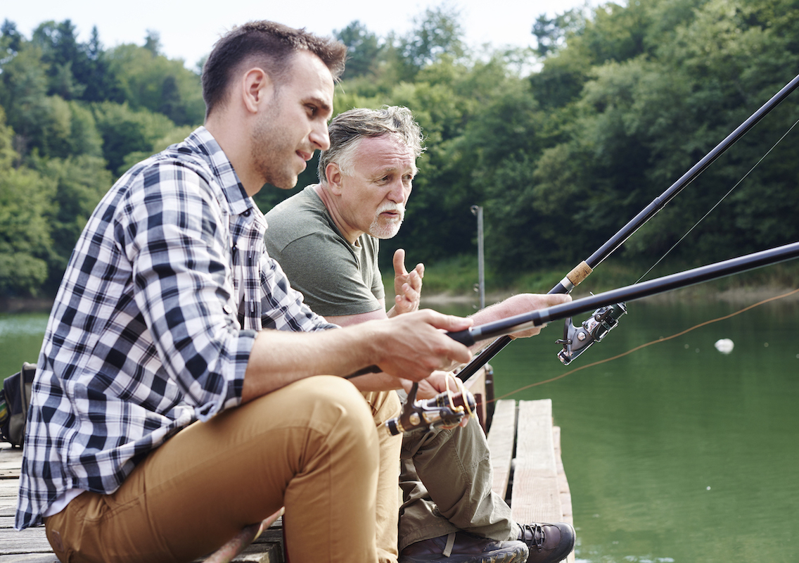 Men talking and fishing together